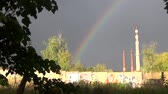 Rainbow in cloudy weather in the industrial area Stock Footage