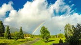 deštivý : Beautiful rainbow over woods at Vysoke Tatry town in High Tatras mountains, Slovakia. Time Lapse. FullHD video