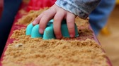Childrens hand playing with sand