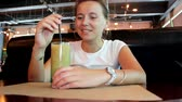 alkoholik : Young woman is drinking a cocktail Dostupné videozáznamy