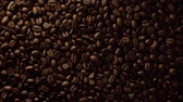 напиток : bouncing coffee beans Стоковые видеозаписи