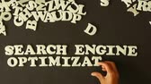 seo : A Person spelling Search Engine Optimization with plastic letters