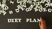 A person spelling Diet Plan with plastic letters Stock Footage