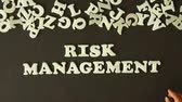 strategy : A person spelling Risk Management with plastic letters Stock Footage