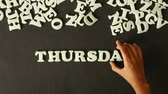 apontamentos : A person spelling Thursday with Plastic letters