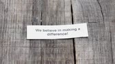management : A We believe in Making a difference paper sign on wood background Stock Footage