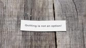 opportunities : A Quitting is not an Option paper sign on wood background