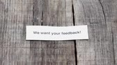 research : A We want your feedback paper sign on wood background