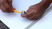 caderno : Person sharpens a pencil Stock Footage