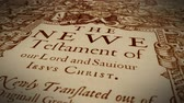 biblia : Dolly shot of an old, historic New Testament Wideo