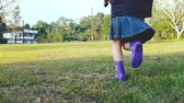 ランニング : Slow motion. Happy asian child running in green field during summer. 動画素材