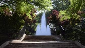 gramado : A large fountain flows in summer behind a set of stairs leading to it Stock Footage