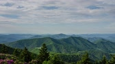 горный хребет : A time lapse of the Blue Ridge Mountains as seen from Grassy Ridge in the Roan Highlands.  The shadow of clouds can be seen on the side of the ridge as they pass by.