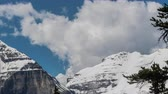 high plain : Time Lapse of Avalanche above Lake Louise while cloud build behind the mountains. Stock Footage