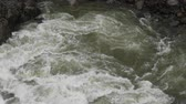 flowing water : Swirling Water in Hellroading Creek from above Stock Footage
