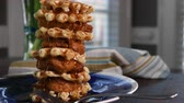 Pouring Too Much Syrup Over Stack of Chicken and Waffles