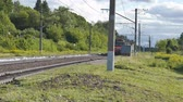 řev : An electric train leaving the railway crossing. Dostupné videozáznamy