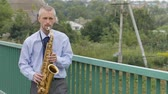 sleepers : A saxophonist plays the saxophone