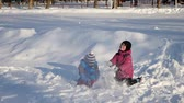 irmãs : Children played in the snow Stock Footage