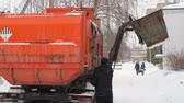 municipal services : Work the garbage cars in winter. Garbage transport car loading itself.