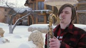 sax : saxophonist plays the saxophone, in winter