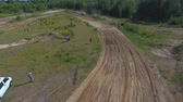 terreno extremo : 10 June 2018 Russian Federation, Bryansk region, Ivot - Extreme sports, cross-country motocross. Shooting with kvadrokoptera. Aerial and video in motion. Camera in motion. Tracking a man riding a motorcycle. The motorcyclist enters the turn on the race tr Vídeos