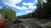 threshold : River rafting kayaking. Overcoming water rapids by boat. Rowing paired paddle. Extreme sports. Water sports. Shooting Action camera.
