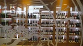 Showcase wine shop. Bottles of wine are on the shelves. SHOP 動画素材