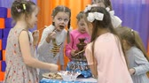 feestzaal : Childrens playroom. Children eat chocolate from a chocolate fountain.