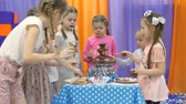 Childrens playroom. Children eat chocolate from a chocolate fountain.
