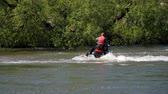 Jet ski on the river. Splashes fly apart.