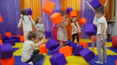Childrens playroom. Play with foam cubes.