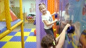 Childrens playroom. Child climbs the wall of a climbing wall.