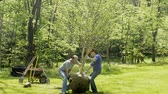 man and woman planting birch tree Стоковые видеозаписи