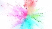 partícula : Colorful powder exploding on white background in super slow motion.