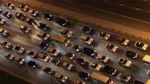 pesado : Top down aerial view of heavy traffic on freeway at night. Stock Footage
