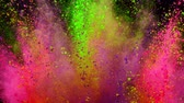 multicolore : Colorful powder exploding on black background in super slow motion.
