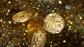 forchetta : Cryptocurrencies Bitcoins flying with gold shiny glitters. 4k, 1000 fps.