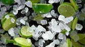 Super Slow Motion of exploding crushed ice with limes towards camera