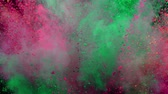 écraser : Colorful powder exploding on black background in super slow motion.