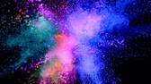 ezmek : Colorful powder exploding on black background in super slow motion.