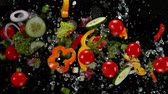 супер : Fresh vegetables with water droplets exploding on black background.