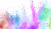Colorful powder exploding on white background in super slow motion.