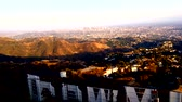 tabela : Bird Flies over Hollywood sign and DTLA Stok Video