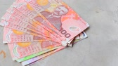 caixa : stack of new zealand dollars bank note on cement floor