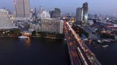 scrapper : drone flying shot of sky scraper over chaopraya river at taksin bridge sathorn road heart of bangkok thailand capital