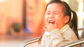 Öğrenciler : asian kid girl laughing with happiness emotion