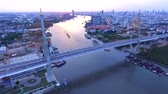desenvolver : aerial view of bhumiphol bridge crossing chaopraya river important landmark and traffic and land transportation in bangkok thailand