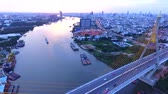 suspensão : aerial view of bhumiphol bridge crossing chaopraya river important landmark and traffic and land transportation in bangkok thailand