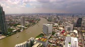 sathorn : aerial view of bangkok skyscraper beside chaopraya river in heart of thailand capital